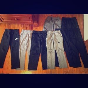 8 pair Nike and UA Dri-Fit pants -boys size small